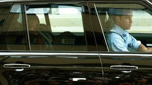Kate can be seen smiling at her son as Prince William drives them to Kensington Palace yesterday.