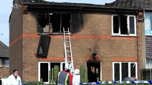 Emergency services attend the scene of a house fire in Buxton, Derbyshire, in which two young children died.