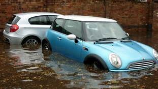 The car park of The Grosvenor pub in Nottingham as a sudden downpour left the area and public house flooded.
