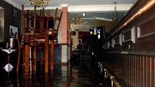 The flooded interior of The Grosvenor pub in Nottingham as a sudden flash flood left a road side pub flooded with rainwater.