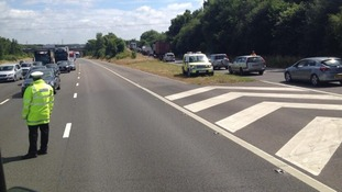 Traffic queues as police divert cars following a minibus crash on the M3