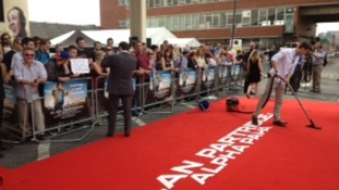 The red carpet being hovered ready for Alan Partridge