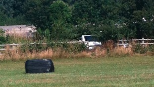 Minibus in a field after it crashed on the M3