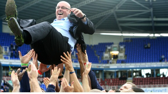 Reading's Manager Brian McDermott is held aloft by his players.