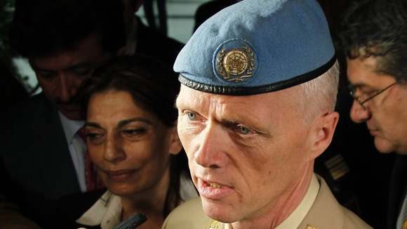 Norwegian Major General Robert Mood arrives at Damascus airport.