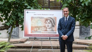 Bank of England Governor Mark Carney, in front of the Jane Austen £10.