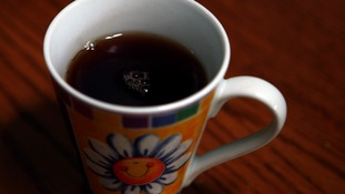 Stock picture of a mug of black tea.