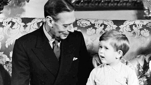 King George VI pictured with Prince Charles on his third birthday in November 1951.