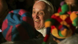 Pope Francis smiles at a crowd at the Saint Francis Hospital.