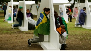 A woman at the confessional booths set up at Quinta da Boa Vista park at the World Youth Day in Rio de Janeiro.