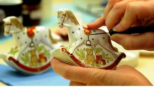 Julie Scott puts the final touches on a Rocking Horse, a souvenir to commemorate the birth of the royal baby.