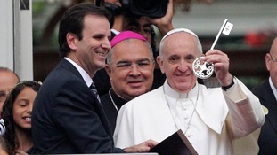 The Pope receives the symbolic key to the city from Rio de Janeiro's Mayor Eduardo Paes