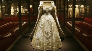 The Queen's Coronation Dress and Robe on display at Buckingham Palace.