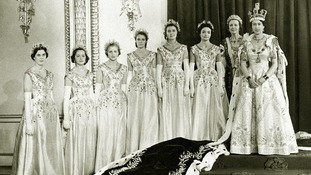 The Queen at Buckingham Palace with her maids of honour after her coronation in Westminster Abbey.