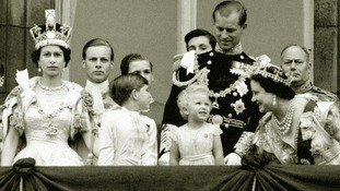 The Queen Prince Charles, Princess Anne, the Duke of Edinburgh, the Queen Mother on the balcony of Buckingham Palace.