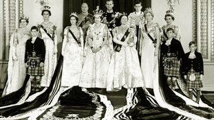 The newly crowned Queen at Buckingham Palace with other members of the Royal family.