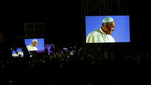 Pope Francis is projected on screens at Copacabana beach in Rio de Janeiro.