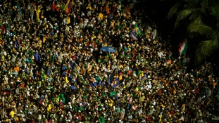 Catholic faithful throng the streets during the arrival of Pope Francis at Copacabana beach.