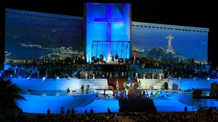 Pope Francis stands on the huge stage while presiding the Catholic Church's World Day of Youth at Copacabana beach.