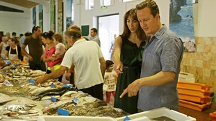 The Camerons visit Portuguese market at start of holiday