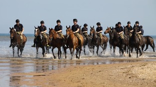 Horses and riders keep their cool at Holkham beach