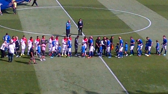 The teams shake hands at the start of today's game