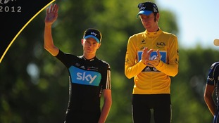 Wiggins with second placed rider and team mate, Froome as they stand on the winners podium at the end the 2012 event.