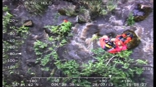 Woman and children winched to safety from river
