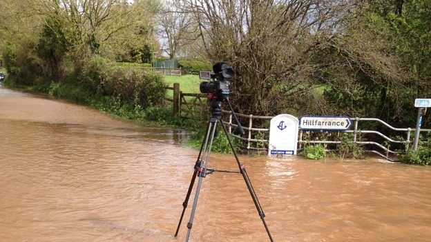camera on tripod on flooded road near Hillfarrance