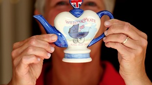 Carol Bridger, of Tony Carter Ceramic Designs, holds up a commemorative teapot created to celebrate the birth of Prince George of Cambridge