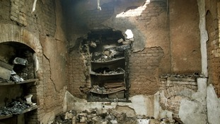 Burnt rooms inside the prison after the midnight raid.