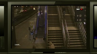 A man is pictured falling down the escalator (on the left) at Leeds train station.