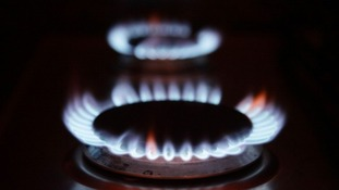 File photo of a British gas bill behind a burning hob.