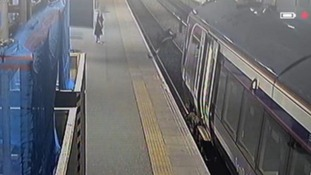 CCTV shows a man falling onto the track after trying to kick a pigeon on the platform.