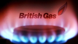 A British Gas bill behind a burning hob.