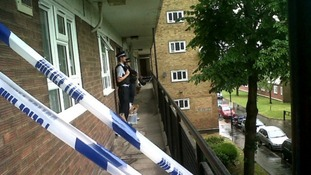 Police stand guard outside one of the properties where the attacks took place.