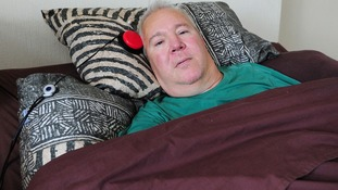 Paralysed road accident victim Paul Lamb at home in Leeds today.