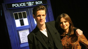 Matt Smith and Jenna-Louise Coleman in front of a Tardis.