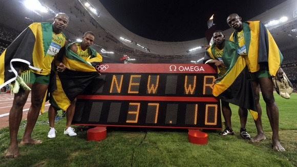Sprinter Michael Frater (second from left) with Usain Bolt and Jamaica team mates