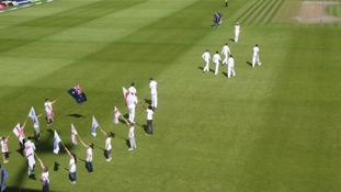 England cricketers walk onto the pitch at Old Trafford in Manchester