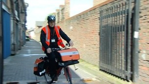 TNT postman on a cycle