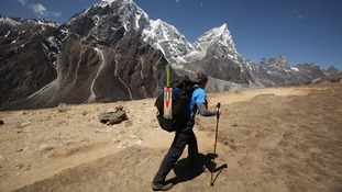 A hiker sets off on an attempt to set the record for the highest game of cricket near Mount Everest base camp