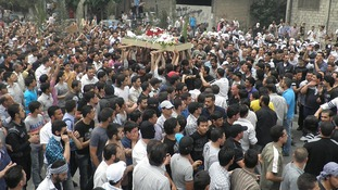 Anti-Syrian regime mourners carry the body of activist Nour al-Zahraa, 23, who was shot by Syrian security forces