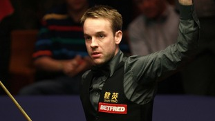 Ali Carter celebrates his victory over Judd Trump in the second round match during the Betfred.com World Snooker Championships at the Crucible Theatre, Sheffield.