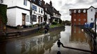 Floodwaters rise around Mill Street, Tewkesbury, as much of England and Wales braced for flooding
