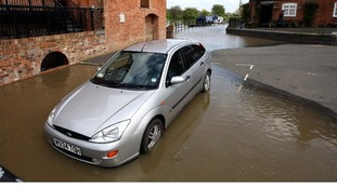 Floodwaters rise around Mill Street, Tewkesbury,