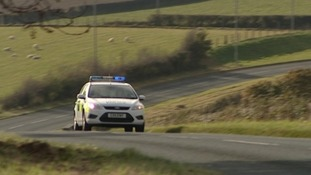 Police driving through countryside