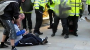 Ian Tomlinson can be seen on the ground during the G20 protests before his death.