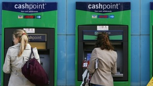 Women use a Lloyds ATM machine
