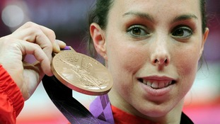 Beth Tweddle celebrates with her Bronze medal after the Women's Uneven Bars Final.